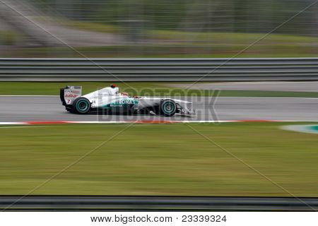 SEPANG, MALAYSIA - APRIL 8: Michael Schumacher of Mercedes GP Petronas F1 Team whizzes on the tracks on practice day of the Petronas Malaysian F1 Grand Prix on April 8, 2011 in Sepang, Malaysia.