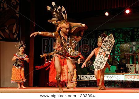 KUCHING, MALAYSIA - MAY 14: Warrior from the indigenous Iban people performs a traditional dance at the Sarawak Cultural Village, May14, 2010 in Kuching. The Ibans were known to be head-hunters in the past.