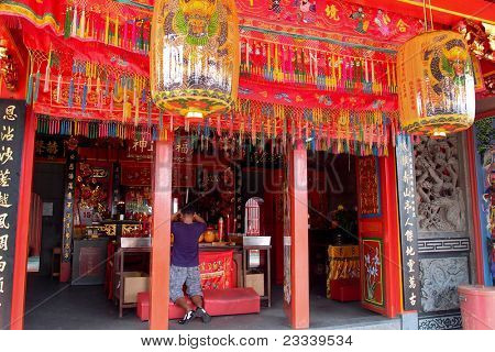 KUCHING, MALAYSIA - MAY 15: Devotee prays to the deities at Tua Pek Kong Temple on May15, 2010 in Kuching. This is the oldest Chinese temple in Kuching over 200 years old.