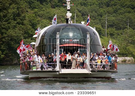 NAMISEOM - JUNE 06: Visitors arrive in Nami Island by ferry on June 06, 2011 in Chuncheon, South Korea. This resort island was formed by the rising water after the Cheongpyeong Dam was built in 1944.