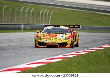 SEPANG - JUNE 17: Siu Yuk Lung (8) in a Lamborghini takes to the tracks of the Sepang International Circuit at the GT Asia Series race on June 17, 2011 in Sepang, Malaysia.