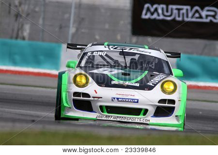 SEPANG - JUNE 17: Sasha Chu (11) of the Asia Racing Team in a Porsche takes to the tracks of the Sepang International Circuit at the GT Asia Series race on June 17, 2011 in Sepang, Malaysia.
