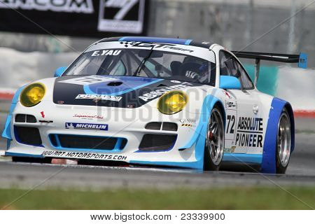 SEPANG - JUNE 17: Eddie Yau of Hong Kong in a Porsche 911 GT3R takes to the tracks of the Sepang International Circuit at the GT Asia Series race on June 17, 2011 in Sepang, Malaysia.