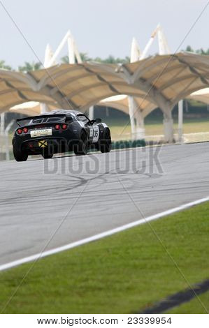 SEPANG - JUNE 17: Ravindra Panchalingam in a Lotus Exige S takes to the tracks of the Sepang International Circuit at the GT Asia Series race on June 17, 2011 in Sepang, Malaysia.