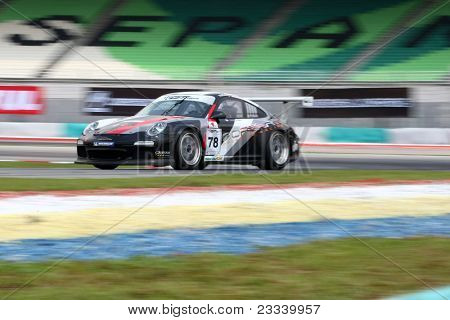 SEPANG - JUNE 17: Shim Ching in a Porsche 997 Cup 3.8 takes to the tracks of the Sepang International Circuit at the GT Asia Series race on June 17, 2011 in Sepang, Malaysia.