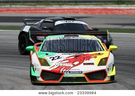 SEPANG - JUNE 17: David Lai of Team Clearwater Racing in a Lamborghini LP560GT3 takes to the tracks of the Sepang International Circuit at the GT Asia Series race on June 17, 2011 in Sepang, Malaysia.