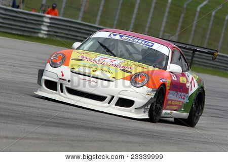 SEPANG - JUNE 17: Jacky Yeung of Hong Kong in a Porsche 997 Cup 3.6 takes to the tracks of the Sepang International Circuit at the GT Asia Series race on June 17, 2011 in Sepang, Malaysia.