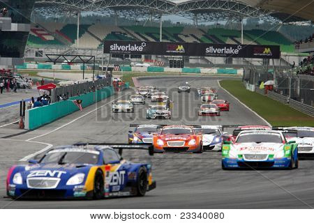 SEPANG - JUNE 19: GT cars take off on a rolling start at the Japan SUPER GT Round 3 race at the Sepang International Circuit on June 19, 2011 in Sepang, Malaysia. The GT500 cars start off in the front
