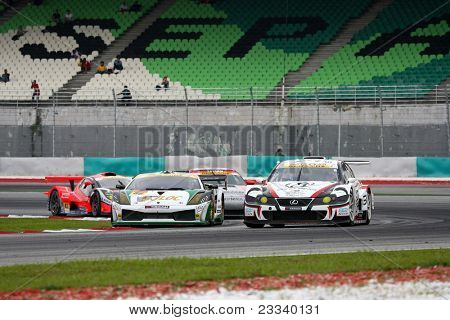 SEPANG - JUNE 19: Cars take turn one of the Sepang International Circuit in a tight pack at the Japan SUPER GT Round 3 race on June 19, 2011 in Sepang, Malaysia.