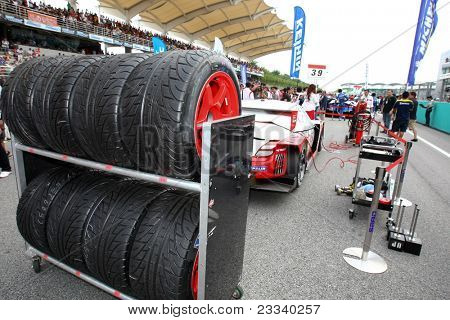 SEPANG - JUNE 19: Lexus Team Sard's pit crew puts the rain tires on standby at the start of the Japan SUPER GT Round 3 race in Sepang International Circuit on June 19, 2011 in Sepang, Malaysia