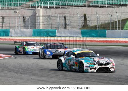 SEPANG, MALAYSIA - JUNE 19: GT cars take turn 1 in tight formation at the Sepang International Circuit during the practice laps of the Japan SUPER GT Round 3 race on June 19, 2011 in Sepang, Malaysia.