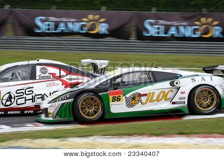 SEPANG, MALAYSIA - JUNE 19: JLOC's Lamborghini Gallardo RGF-3 car races down turn 2 of the Sepang International Circuit during the Japan SUPER GT Round 3 race on June 19, 2011 in Sepang, Malaysia.