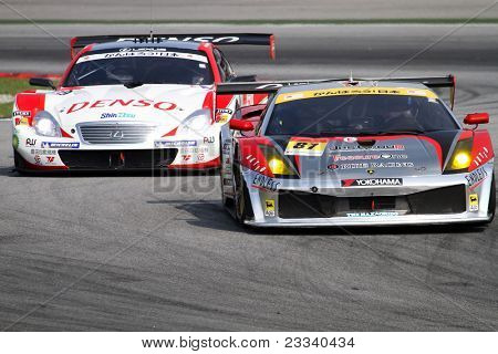 SEPANG - JUNE 19: The Lamborghini Gallardo (87) of the JLOC accelerates into turn 2 of the Sepang International Circuit tracks in the Japan SUPER GT Round 3 race on June 19, 2011 in Sepang, Malaysia.