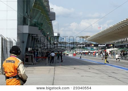 SEPANG, MALAYSIA - JUNE 18: The race marshall eyeballs the pitlane during the practice laps on the Sepang International Circuit during the Japan SUPER GT Round 3 on June 18, 2011 in Sepang, Malaysia.