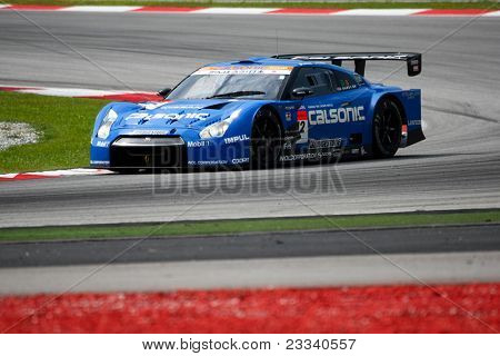 SEPANG, MALAYSIA - JUNE 18: The Nissan GTR R35 car of Team IMPUL does practice laps on the Sepang International Circuit during the Japan SUPER GT Round 3 on June 18, 2011 in Sepang, Malaysia.