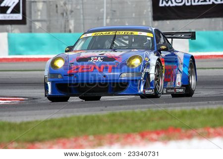 SEPANG, MALAYSIA - JUNE 18: The Porsche car of Samurai Team Tsuchiya puts in some practice laps in the Sepang International Circuit at the Japan SUPER GT Round 3 on June 18, 2011 in Sepang, Malaysia.