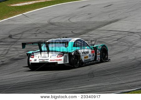 SEPANG - JUNE 18: The Lexus SC430 car of Lexus Team Petronas Tom's puts in some practice laps in the Sepang International Circuit at the Japan SUPER GT Round 3 on June 18, 2011 in Sepang, Malaysia.