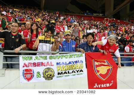 BUKIT JALIL, MALAYSIA - JULY 13: Soccer fans cheer during the Arsenal vs Malaysia game in the National Stadium on July 13, 2011, Bukit Jalil, Malaysia. English league team Arsenal is on an Asia Tour.