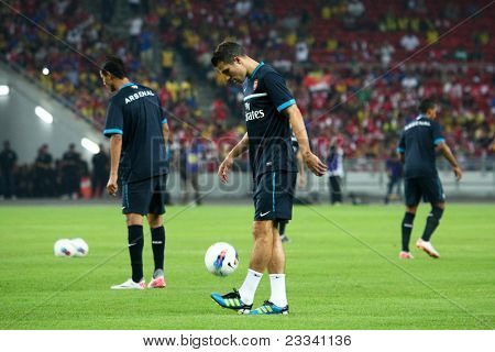 BUKIT JALIL, MALAYSIA - JULY 13: Arsenal's captain Robin van Persie warms up before the game against Malaysia on July 13, 2011, Bukit Jalil, Malaysia. English league team Arsenal is on an Asia Tour.
