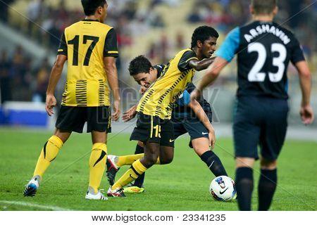 BUKIT JALIL - JULY 13: K. Gurusamy (15) dribbles past Arsenal's Samir Nasri in a friendly match on July 13, 2011 in Stadium Bukit Jalil, Malaysia. English Premier League team Arsenal beat Malaysia 4-0