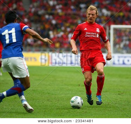 BUKIT JALIL, MALAYSIA-  JULY 16: Liverpool's Dirk Kuyt controls the ball in the game against Malaysia at the National Stadium on July 16, 2011, Bukit Jalil, Malaysia. Liverpool won 6-3.