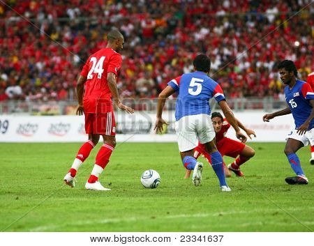 BUKIT JALIL, MALAYSIA - JULY 16: Liverpool's David Ngog (24) and Malaysia's M. Rizal (5) go after a loose ball in this game played at the National Stadium on July 16, 2011, Bukit Jalil, Malaysia.