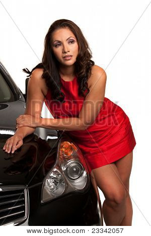 Sexy Looking Young Asian Female Standing by the Car Isolated
