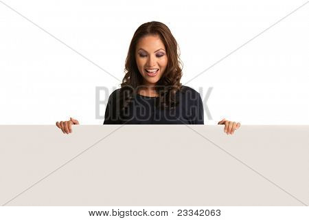 Smiling Asian Female Pointing to a Blank Board Isolated