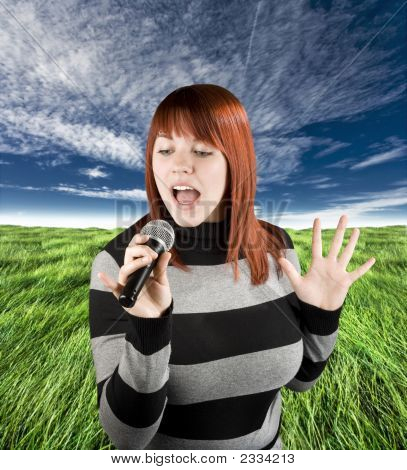 Redhead Girl Singing Karaoke On Microphone