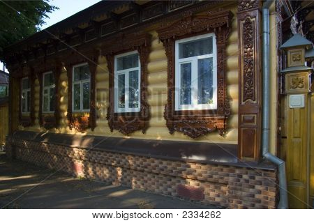 House With Carving At Windows