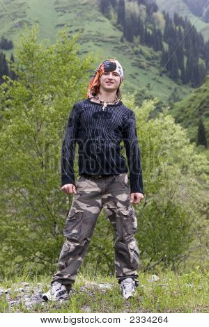 Sport Teenager In Bandana In Summer Mountains After Rain
