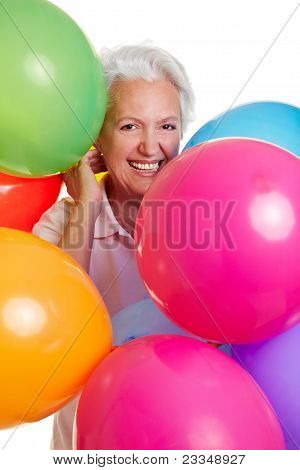 Senior Woman With Many Balloons
