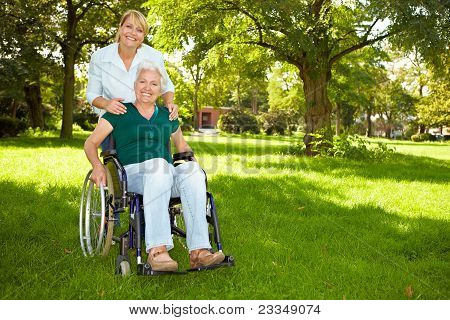 Senior Woman In Wheelchair In Nature