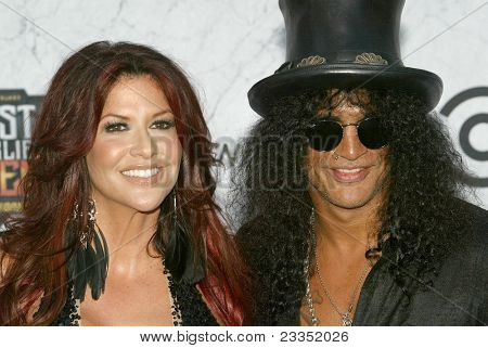 CULVER CITY, CA - SEPT. 10: Slash (R) and wife arrive at the Comedy Central Roast of Charlie Sheen at Sony Studios on Sept. 10, 2011 in Culver City, CA.