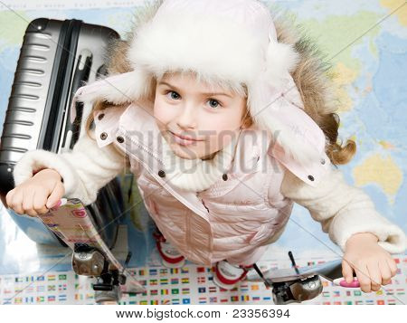 Travel, ski - Ready for the travel for winter vacation (Blurred map background)
