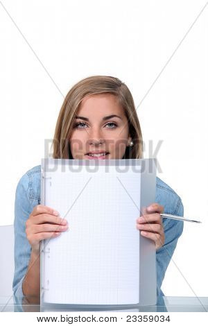 Blond teenager holding blank sheet of paper