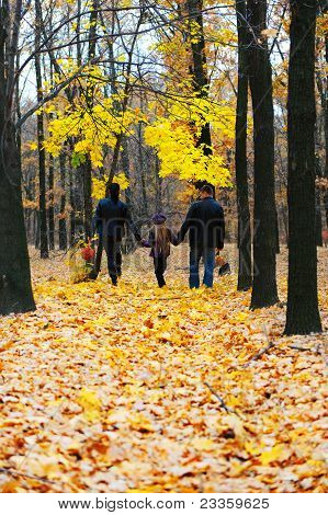 Family In Autumn Forest