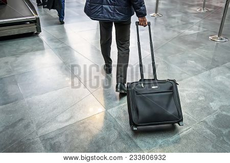 poster of Man Traveller With Travel Suitcase Or Luggage Walking In Airport Terminal Walkway For Vacation Trave