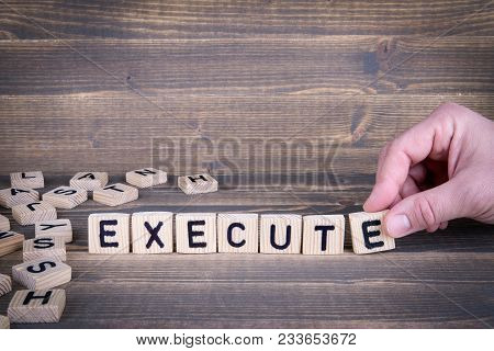 Execute Wooden Letters On The