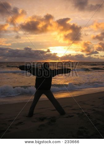Girl Expressing Freedom In Sunset