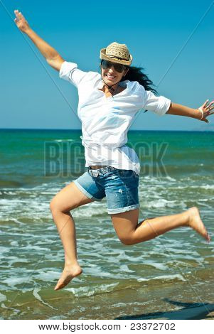 Jumping Happy Woman On The  Beach