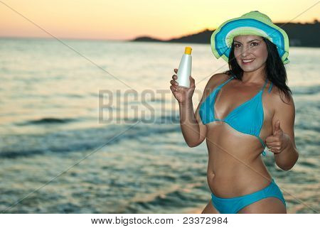 Woman Holding Suntan Lotion