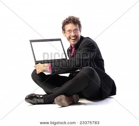 Smiling businessman showing the screen of a laptop