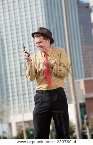 Upset Businessman With Cellphone