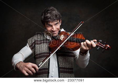 Man Plays A Viloin