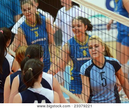 KAPOSVAR, HUNGARY - APRIL 24: Competitors shake hands after the Hungarian NB I. League woman volleyball game Kaposvar (blue) vs Ujbuda (black), April 24, 2011 in Kaposvar, Hungary.