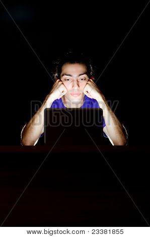 Hacker sitting in dark room