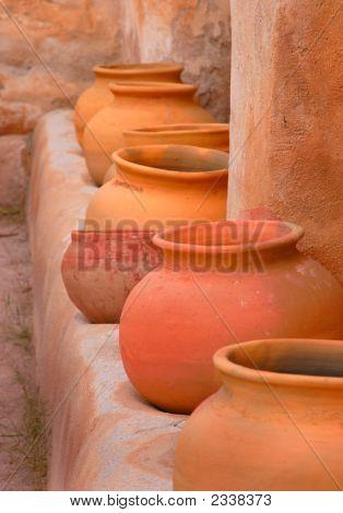 Pots And Adobe Wall