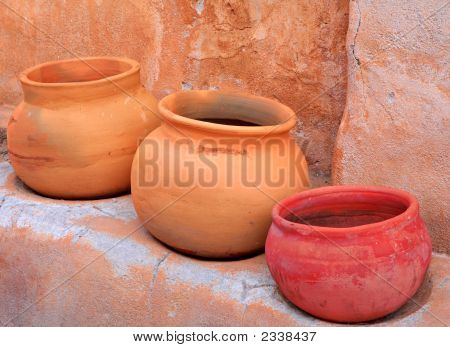 3 Pots And Adobe Wall