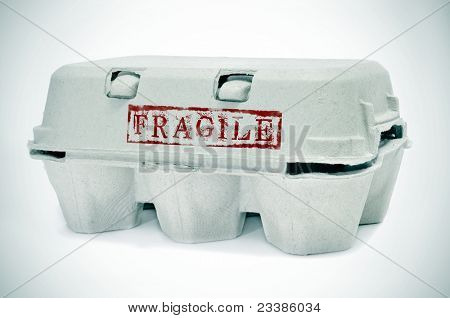 an egg carton with word fragile stamped on it